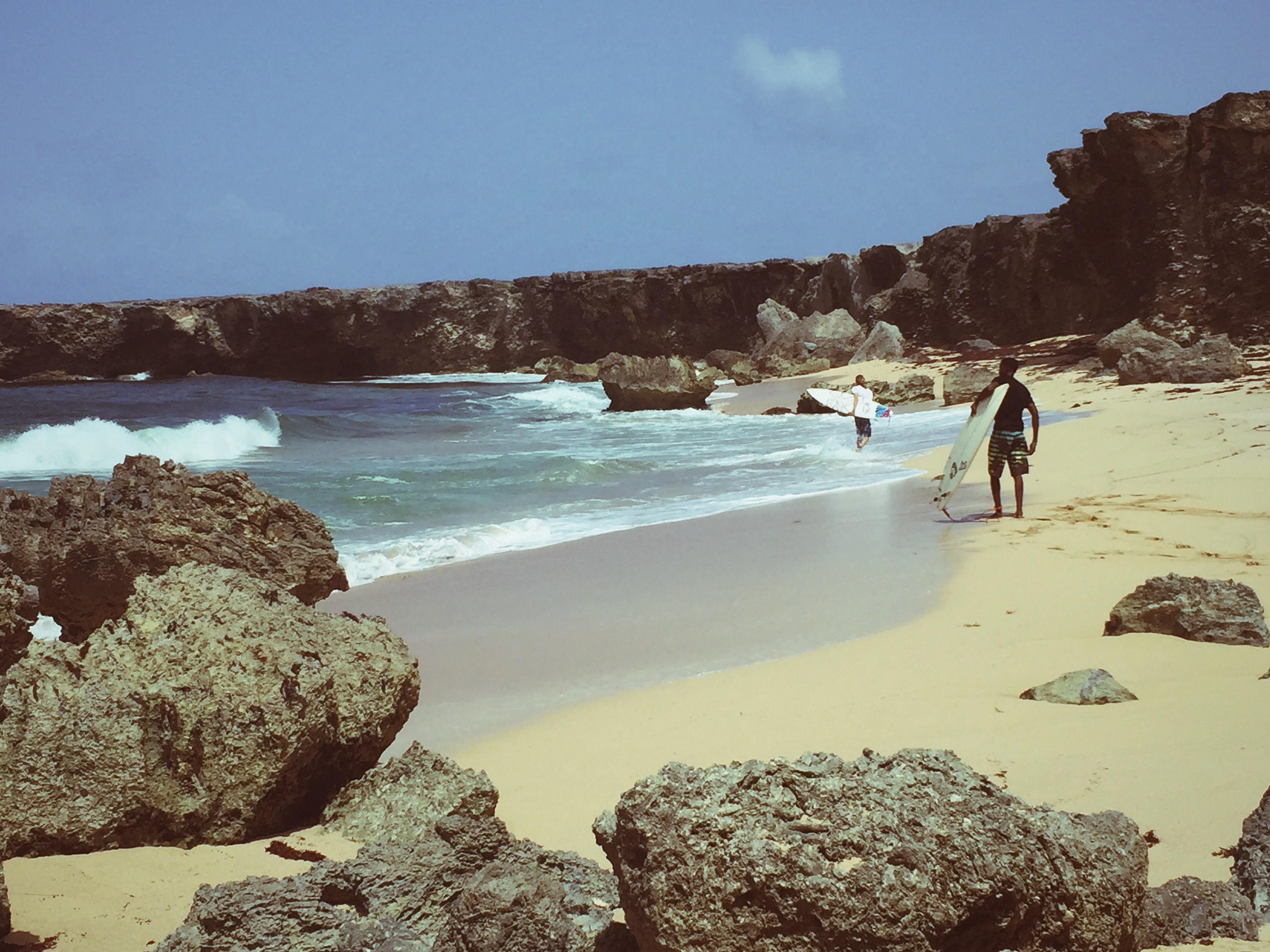 Beach scene with surfers