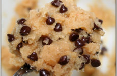 Close-up of a scrumptious gob of chocolate chip cookie dough on a silver spoon.