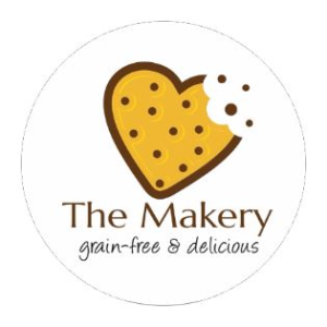 Round personalized label from CardsDirect.com with a cookie in the shape of a heart and a bite taken out of the corner, along with the words 'The Makery, grain-free and delicious' written underneath.