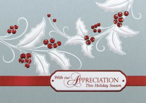 A business holiday card decorated with holly and berries of white and red foil on a shiny silver background. The text reads 'With Our Appreciation This Holiday Season' in red letters.