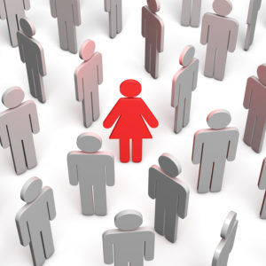 A crowd of gray faceless avatar icons representing male figures surround a red female icon in the middle.
