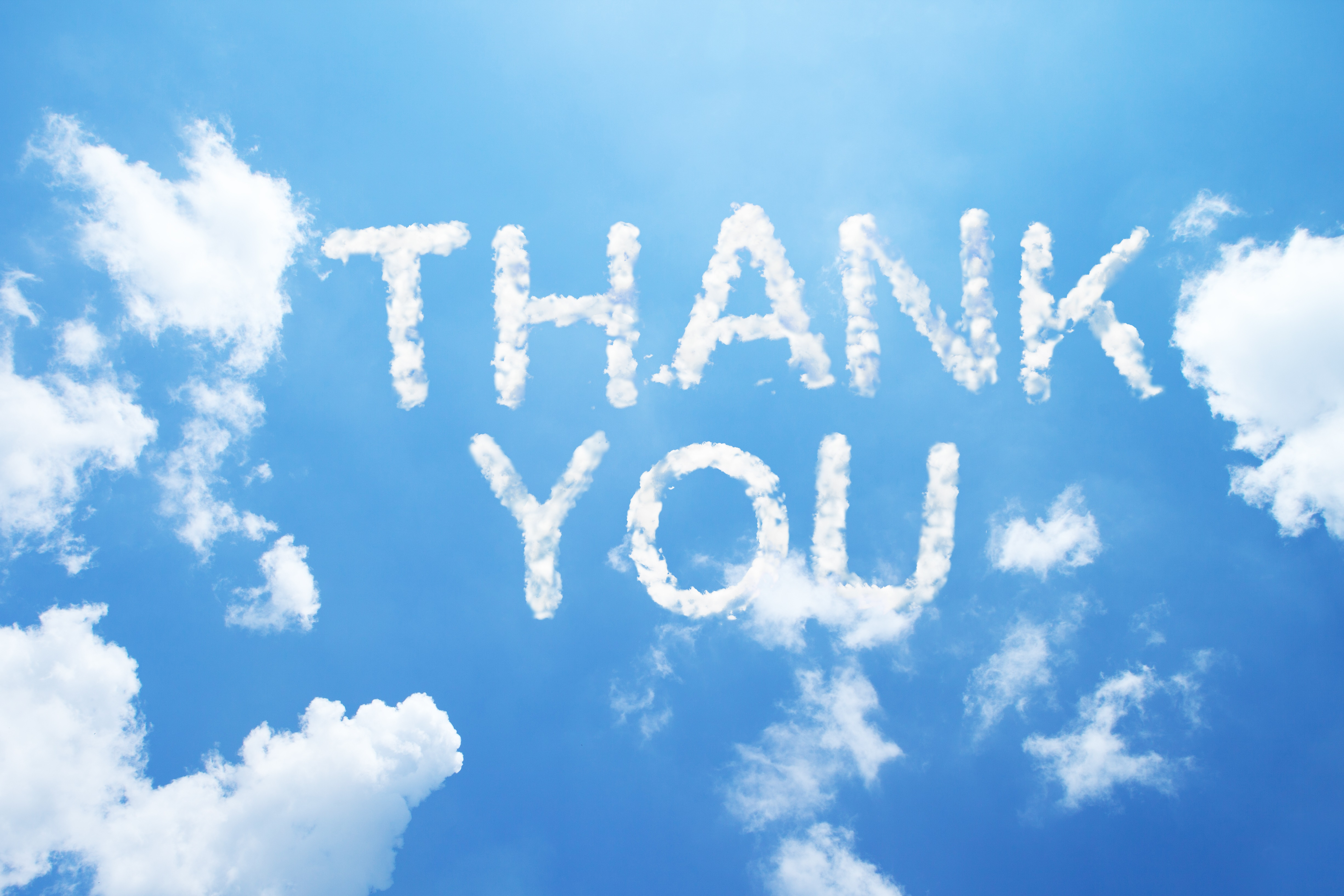 Thank you is written out in a blue sky.