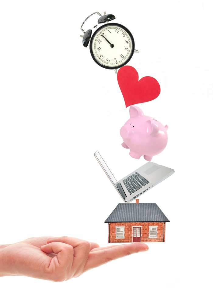 Outstretched hand balances several icons including a house, a laptop, a piggy bank, a heart, and a clock.
