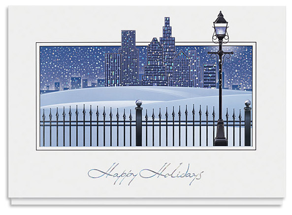 A cityscape presented in varying tones of blue with the words 'Happy Holidays' written underneath.