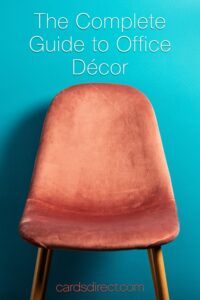 Copper chair with an orange velour seat aginst a blue background with white letters that read The Complete Guide to Office Décor.