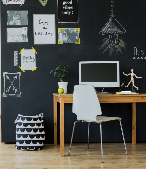 Various wall art in a trendy home office.