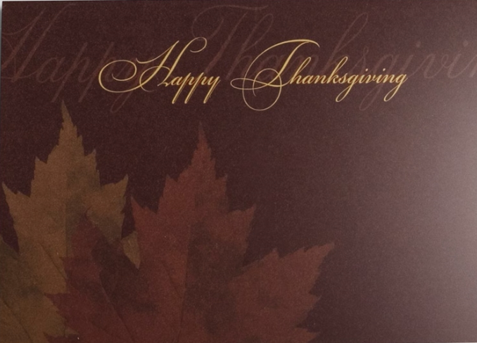 This greeting card offers a classically stylish way to send Thanksgiving wishes. The duel leaf design in autumn colors against a brown-burgundy background combines with a simple message of 'Happy Thanksgiving' in a gold script.