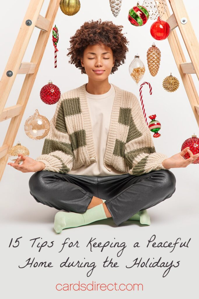 Young black woman sitting under a  wooden ladder strung with Christmas ornaments meditating above a message that reads 15 Tips for Keeping a Peaceful Home During the Holidays in a black script.