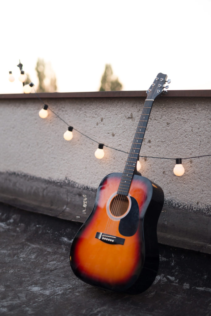 Picture of nice stringed acoustic guitar on rooftop