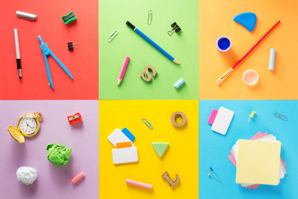Office and school supplies at abstract colorful background texture