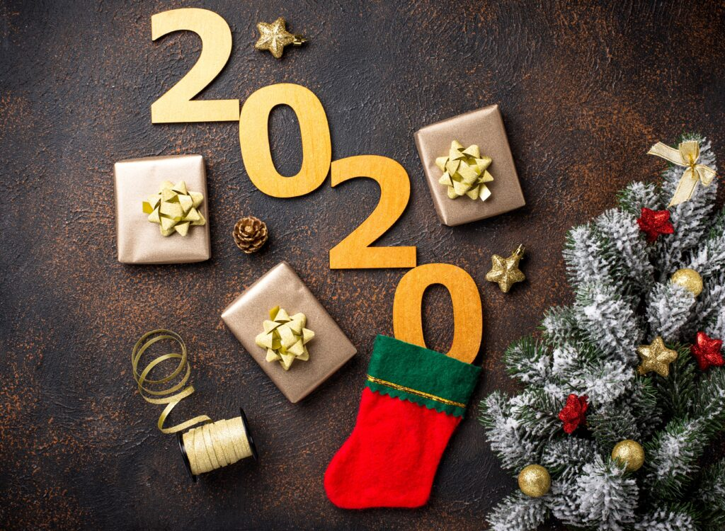 Christmas New Year 2020 background with gift boxes in golden paper