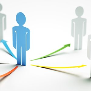 An illustration showing a blue person in the middle with multicolored arrows pointing for four grey people.