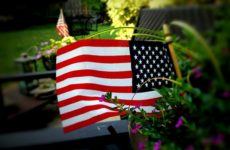 A mini American flag in a planting pot