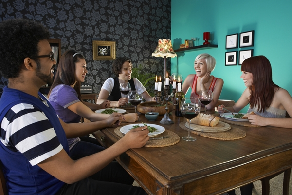 A group of people eating at a table.