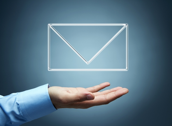 A hand outstretched presenting an illustrated envelope icon.